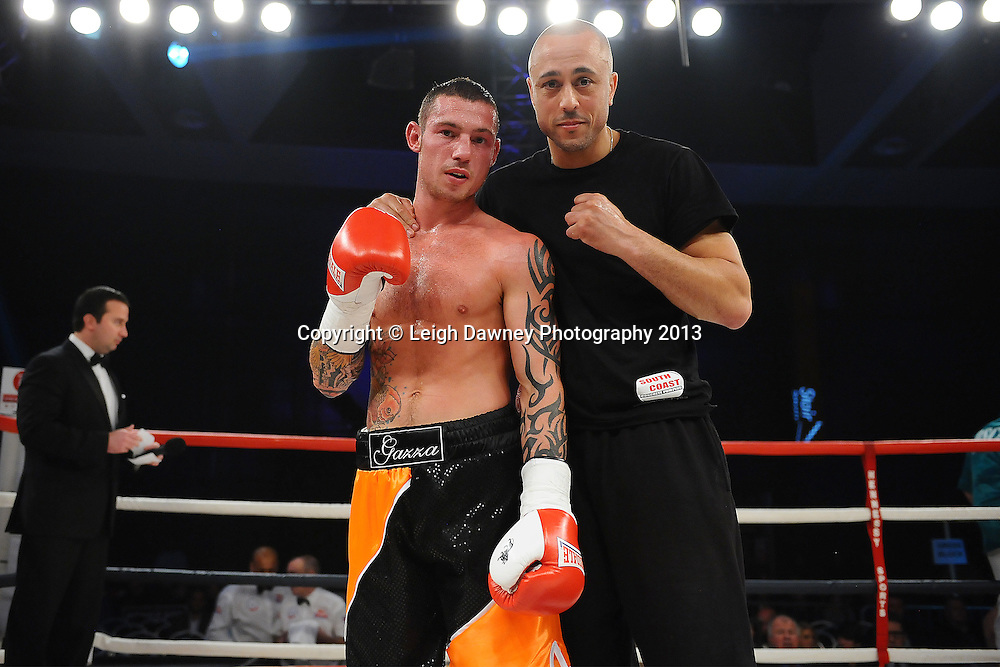 Garry Neale and trainer pose for the press after defeating Simas Volosinas in a Light Welter weight contest. Glow, Bluewater, Kent, UK. Hennessy Sports © Leigh Dawney Photography 2013.