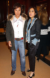 ANDY & PATTI WONG at a party at Ralph Lauren, Bond Street, London in support of the NSPCC's Full Stop campaign on 21st March 2006.<br /><br />NON EXCLUSIVE - WORLD RIGHTS