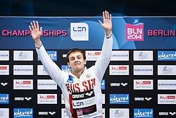 Victor Minibaev of Russia celebrates on the podium after winning Gold in the Mens 10m Platform Final - Photo mandatory by-line: Rogan Thomson/JMP - 07966 386802 - 23/08/2014 - SPORT - DIVING - Berlin, Germany - SSE im Europa-Sportpark - 32nd LEN European Swimming Championships 2014 - Day 11.