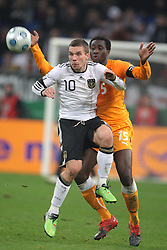 LUKAS PODOLSKI & SOULEYMANE BAMBA.GERMANY V IVORY COAST.GERMANY V IVORY COAST.VELTINS ARENA, GELSENKIRCHEN, GERMANY.18 November 2009.GAA3962..  .WARNING! This Photograph May Only Be Used For Newspaper And/Or Magazine Editorial Purposes..May Not Be Used For, Internet/Online Usage Nor For Publications Involving 1 player, 1 Club Or 1 Competition,.Without Written Authorisation From Football DataCo Ltd..For Any Queries, Please Contact Football DataCo Ltd on +44 (0) 207 864 9121