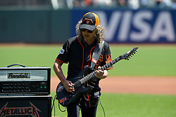 SAN FRANCISCO, CA - MAY 02:  Recording artist Kirk Hammett of the rock band Metallica performs the National Anthem before the game between the San Francisco Giants and the Los Angeles Angels of Anaheim at AT&T Park on May 2, 2015 in San Francisco, California.  The San Francisco Giants defeated the Los Angeles Angels of Anaheim 5-4. (Photo by Jason O. Watson/Getty Images) *** Local Caption *** Kirk Hammett
