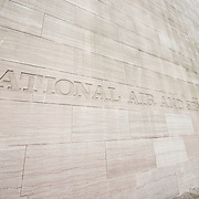 The sign etched into the sandstone wall at the Smithsonian Institution's National Air and Space Museum on the National Mall in Washington DC. The Air and Space Museum, which focuses on the hsitory of aviation and space exploration, is one of the most visited museums in the world.