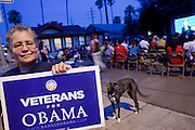 02 OCTOBER 2008 -- PHOENIX, AZ: VICENTA LANNON, a member of Veterans for Obama, waves to motorists on a Phoenix street during the Vice Presidential debate, Thursday night. About 200 people, mostly supporters of Democratic Presidential candidate Barack Obama gathered in a vacant lot in Phoenix in 100 degree heat to watch Vice Presidential debate between Gov. Sarah Palin and Sen. Joe Biden. Photo by Jack Kurtz