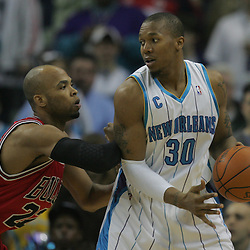 Jan 29, 2010; New Orleans, LA, USA; New Orleans Hornets forward David West (30) drives in against Chicago Bulls forward Taj Gibson (22) during the first half at the New Orleans Arena. Mandatory Credit: Derick E. Hingle-US PRESSWIRE