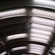 December 12, 2016 - New York, NY :  A work light hangs from the ceiling above an elevator (not pictured) in the 72nd Street Second Avenue subway station. After years of delays, the new subway line is preparing to welcome its first straphangers. CREDIT: Karsten Moran for The New York Times