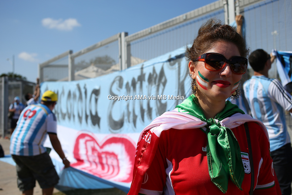 A fan of Iran with a painted face