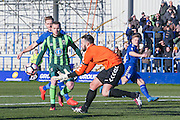 Curzon Ashton goalkeeper Hakan Burton (1)  collects the ball during the The FA Cup match between Curzon Ashton and AFC Wimbledon at Tameside Stadium, Ashton Under Lyne, United Kingdom on 4 December 2016. Photo by Simon Davies.