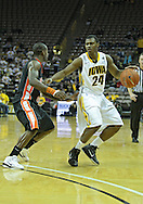 December 04 2010: Iowa Hawkeyes guard Bryce Cartwright (24) works against Idaho State Bengals guard Broderick Gilchrest (2) during the second half of their NCAA basketball game at Carver-Hawkeye Arena in Iowa City, Iowa on December 4, 2010. Iowa won 70-53.