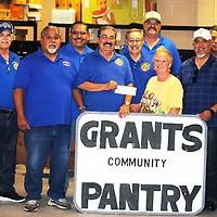 Members of the Grants Knights of Columbus present a $500 check to the Grants Community Pantry Thursday. The pantry said the $500 could buy up to 5,000 pounds of food. The Knights of Columbus is a Catholic-men's fraternity and the Grants council is Council No. 3683.