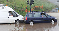 © Licensed to London News Pictures. 30/05/2013<br /> <br /> Saltburn, Cleveland, United Kingdom<br /> <br /> A van driver comes to the assistance of a driver who stalled his vehicle in deep water as heavy overnight rain causes flooding in Saltburn on the A174 coast road near to the Ship Inn on the seafront in the town.<br /> <br /> Photo credit : Ian Forsyth/LNP