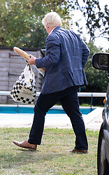 © Licensed to London News Pictures. 10/09/2018. Thame, UK. Boris Johnson arrives at his Oxfordshire house with a French loaf and a bag of food from Marks and Spencers. Last week it was announced that Boris Johnson and his wife Marina Wheeler are getting divorced. Photo credit: Peter Macdiarmid/LNP