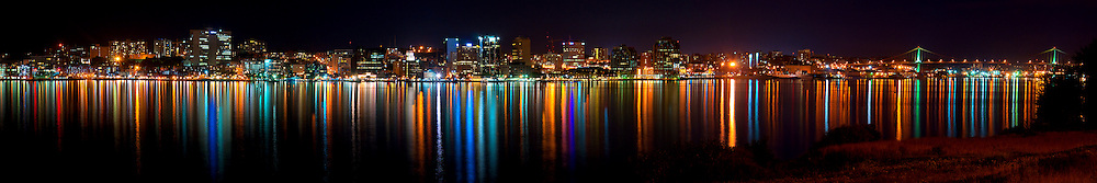 Panoramic view of the Halifax, Nova Scotia skyline at night including the MacDonald Bridge, as seen from the Woodside ferry terminal in Dartmouth