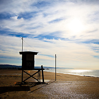 Photo of Orange County lifeguard tower 10 in Newport Beach on Balboa Peninsula. Newport Beach is a beach community along the Pacific Ocean in Southern California.