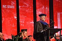Interim Graduate School dean Peter Harries congratulates graduates.