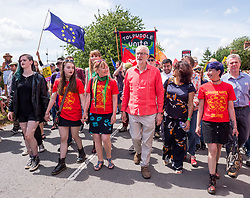 © Licensed to London News Pictures. 21/07/2019; Tolpuddle, Dorset, UK. JEREMY CORBYN, leader of the Labour Party, with ANGELA RAYNER MP (in green dress), leads the parade of trades unions through the village of Tolpuddle, part of the Tolpuddle Martyrs Festival. The Tolpuddle Martyrs Festival for trade unionism, held every year, commemorates the birth of the trade union movement in the 19th century when the Tolpuddle Martyrs were transported to Australia for forming a trade union of agricultural labourers in Dorset. Photo credit: Simon Chapman/LNP.