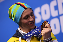 The XXII Winter Olympic Games 2014 in Sotchi, Olympics, Olympische Winterspiele Sotschi 2014<br /> Eric Frenzel (Germany),winner of the gold medal in the individual normal hill event in Nordic combined at the XXII Olympic Winter Games in Sochi, during the flower ceremony