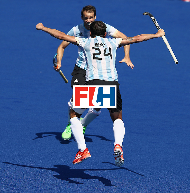RIO DE JANEIRO, BRAZIL - AUGUST 14:  Facundo Callioni of Argentina celebrates with team mate Manuel Brunet after their 2-1 victory during the Men's hockey quarter final match between Spain and Argentina on Day 9 of the Rio 2016 Olympic Games at the Olympic Hockey Centre on August 14, 2016 in Rio de Janeiro, Brazil.  (Photo by David Rogers/Getty Images)