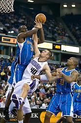 November 29, 2009; Sacramento, CA, USA;  Sacramento Kings forward Jon Brockman (40) fouls New Orleans Hornets center Emeka Okafor (50) on a loose ball during the fourth quarter at the ARCO Arena.  Sacramento defeated New Orleans 112-96.