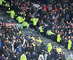 Nottingham Forest fans celebrate in front of the Derby County fans as Nottingham Forest's Ben Osborn celebrates the winning goal - Photo mandatory by-line: Dougie Allward/JMP - Mobile: 07966 386802 - 17/01/2015 - SPORT - Football - Derby - iPro Stadium - Derby County v Nottingham Forest - Sky Bet Championship