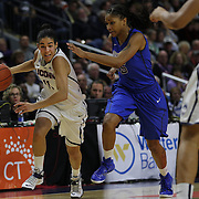 Kia Nurse, (left), UConn, drives past Mart'e Grays, DePaul,  during the UConn Vs DePaul, NCAA Women's College basketball game at Webster Bank Arena, Bridgeport, Connecticut, USA. 19th December 2014