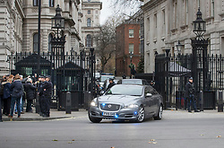 © Licensed to London News Pictures. 06/12/2017. London, UK. A convoy carrying Prime Minister Theresa May leaves Downing Street through the front gates as she heads to Parliament for Prime Minister's Questions. Yesterday a  plot to attack Downing Street to kill Mrs May was revealed. Two men have appeared in court this morning.  Photo credit: Peter Macdiarmid/LNP