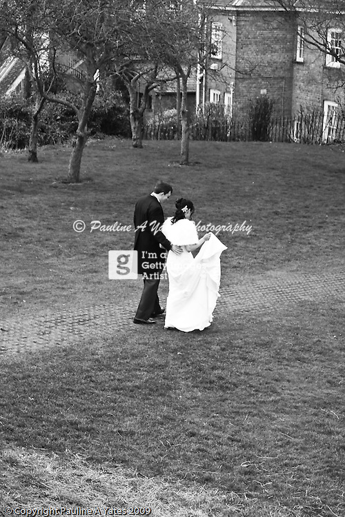 The bride and groom take a walk ahead of the bridal party for a quiet moment to themselves before the reception