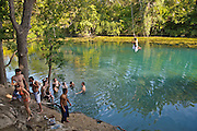 Youngsters enjoy the fresh waters of a river at Zilker Park, Austin, Texas