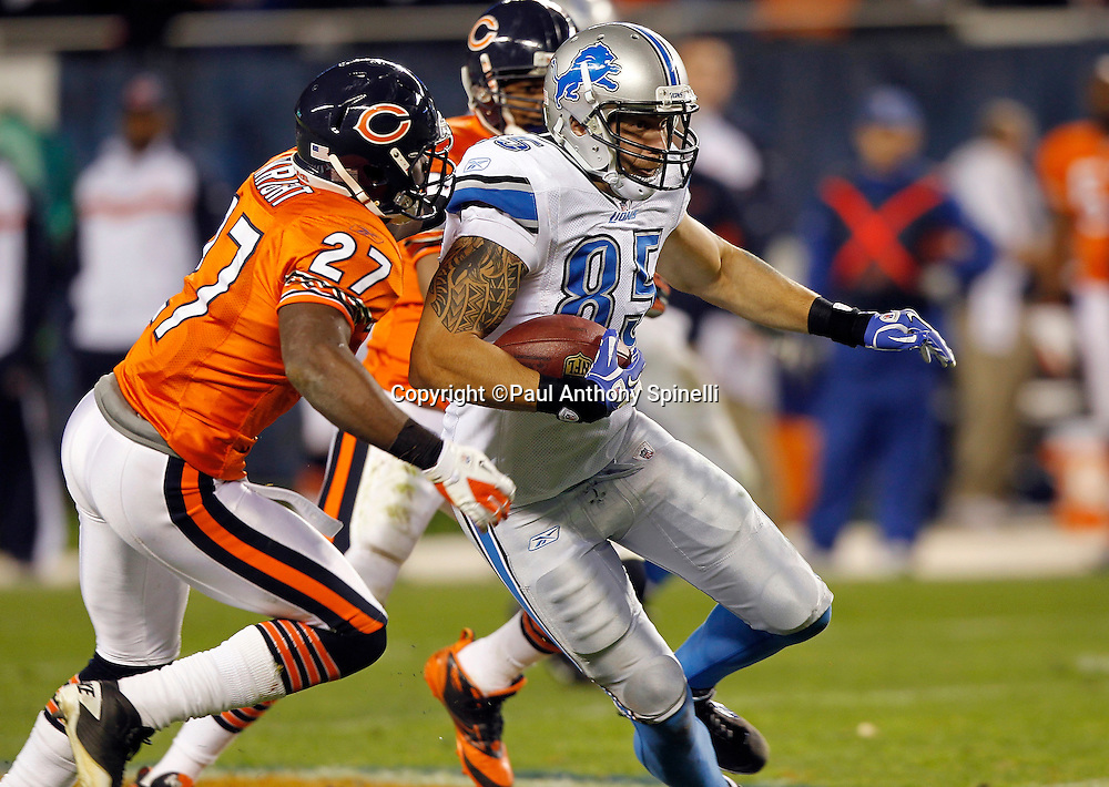 Detroit Lions tight end Tony Scheffler (85) catches a pass and tries to elude a tackle by Chicago Bears strong safety Major Wright (27) during the NFL week 10 football game against the Chicago Bears on Sunday, November 13, 2011 in Chicago, Illinois. The Bears won the game 37-13. ©Paul Anthony Spinelli