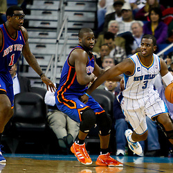 December 3, 2010; New Orleans, LA, USA; New Orleans Hornets point guard Chris Paul (3) drives past New York Knicks point guard Raymond Felton (2) during the second half at the New Orleans Arena. The Knicks defeated the Hornets 100-92. Mandatory Credit: Derick E. Hingle