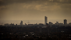 © Licensed to London News Pictures . 20/02/2014 . Manchester , UK . Landscape view across Manchester taken from Saddleworth near Oldham , featuring the city's iconic Beetham Tower to the right of centre , the Manchester City Stadium ( Etihad )  in the centre . Photo credit : Joel Goodman/LNP