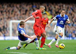Liverpool's Glen Johnson avoids a challenge from Everton's James McCarthy - Photo mandatory by-line: Dougie Allward/JMP - Tel: Mobile: 07966 386802 23/11/2013 - SPORT - Football - Liverpool - Merseyside derby - Goodison Park - Everton v Liverpool - Barclays Premier League