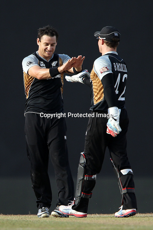 Nathan McCullum and Brendon McCullum celebrate the wicket of Dwayne Bravo of The West Indies during the ICC World Twenty20 Super Eights match between The West Indies and New Zealand held at the  Pallekele Stadium in Kandy, Sri Lanka on the 1st October 2012<br /> <br /> Photo by Ron Gaunt/SPORTZPICS/PHOTOSPORT