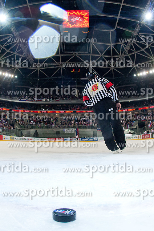 Puck and referee during ice-hockey match between Austria and Slovenia at IIHF World Championship DIV. I Group A Slovenia 2012, on April 21, 2012 at SRC Stozice, Ljubljana, Slovenia. (Photo By Matic Klansek Velej / Sportida.com)