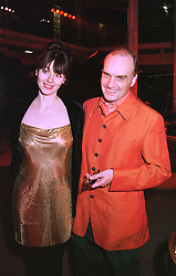 MR & MRS NICHOLAS COLERIDGE he is Managing director of Conde Nast, at a party in London on 31st January 1998.MEZ 29