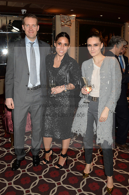 Left to right, JAMES & LILY HODGES and AYTAN ELDAROVA at the Pig Pledge Evening at Club no41, 41 Conduit Street, London on 10th March 2014.