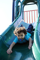 Making the most of stellar weather on Sunday afternoon, children in east Salinas enjoyed the chance to just play. Coming down the slide at La Paz Park is three year-old Christopher Arambula, fearless and face-first. His parents stood close by, but let him discover his limits.