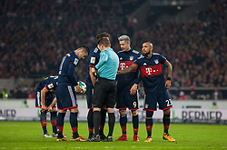 December 16, 2017 - Stuttgart, Germany - Bayerns Arturo Vidal and Robert Lewandowski discuss with the referee during the German first division Bundesliga football match between VfB Stuttgart and Bayern Munich on December 16, 2017 in Stuttgart, Germany. (Credit Image: © Bartek Langer/NurPhoto via ZUMA Press)