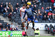 Charlton Athletic defender (on loan from Chelsea) Jay Dasilva (22)  heads the ball under pressure from Milton Keynes Dons defender Callum Brittain (25) during the EFL Sky Bet League 1 match between Milton Keynes Dons and Charlton Athletic at stadium:mk, Milton Keynes, England on 17 February 2018. Picture by Dennis Goodwin.