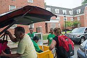 President and First Lady McDavis assist sophomore Laura Conley (Right)  and her family during move- in day on East Green. Photo by Ben Siegel