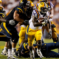 Sep 25, 2010; Baton Rouge, LA, USA; LSU Tigers running back Stevan Ridley (34) runs against the West Virginia Mountaineers during the second half at Tiger Stadium. LSU defeated West Virginia 20-14.  Mandatory Credit: Derick E. Hingle