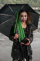 LYON, FRANCE - OCTOBER 12: A &quot;zombie walk&quot; devoted to  the &ldquo;Umbrella&rdquo;<br /> The Zombie Walk in Lyon is the oldest event of this kind organized in France.<br /> Made in the spirit of a free and open event, almost 1200 people were present.<br /> The event is organized by volunteers  with the own funds of the AOA Production,  responsible association for numerous cultural events in Lyon for eight years .<br /> The zombie walk is one of the most popular event, and a great meeting each autumn,<br /> (Photo by Bruno Vigneron/Getty Images)