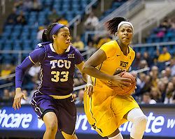 West Virginia Mountaineers guard Bria Holmes (23) drives past TCU Horned Frogs guard Donielle Breaux (33) at the WVU Coliseum.
