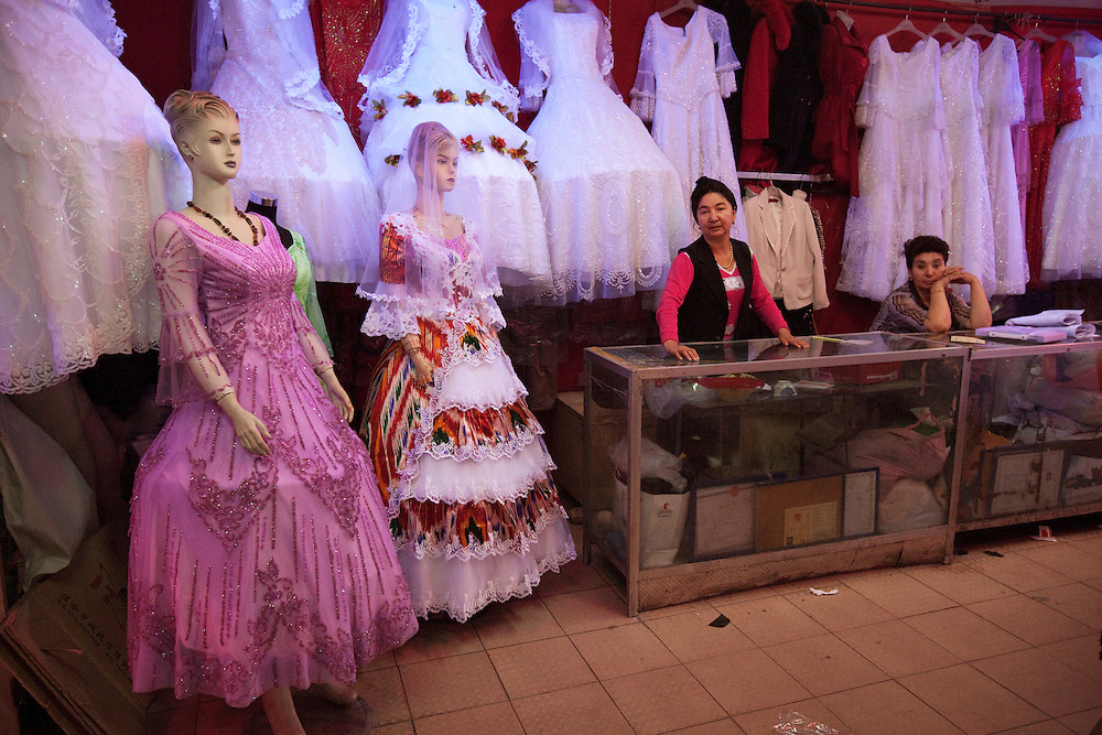 A small wedding dress store in the downtown undepass shopping mall. Kashgar (Kashi in Chinese) is in Xinjiang province in the extreme west of China at the edge of the Taklamakan Desert. It has a long history as an important trading center at the junction of the two branches of the ancient silk road. The Old town of Kashgar is one of the best-preserved examples of a traditional Islamic cities in Central Asia but is today under constant threat of being razed by plans of modernization initiated by the Chinese government.