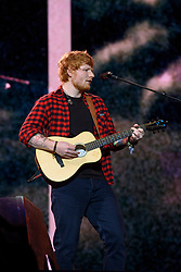 Ed Sheeran performing on the Pyramid Stage during the Glastonbury Festival at Worthy Farm in Pilton, Somerset. Picture date: Sunday June 25th, 2017. Photo credit should read: Matt Crossick/ EMPICS Entertainment.