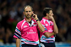 Referee Romain Poite consults the television match official (TMO) - Mandatory byline: Patrick Khachfe/JMP - 07966 386802 - 24/09/2015 - RUGBY UNION - The Stadium, Queen Elizabeth Olympic Park - London, England - New Zealand v Namibia - Rugby World Cup 2015 Pool C.