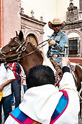 A Roman Catholic priest blesses a cowboy on his horse during the annual blessing of the animals on the feast day of San Antonio Abad at Oratorio de San Felipe Neri church in the historic center of San Miguel de Allende, Guanajuato, Mexico.