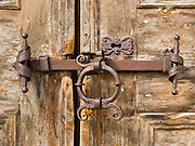 """An iron bolt stops a door in Val Susauna, Graubünden canton, Switzerland, the Alps, Europe. The Swiss valley of Engadine translates as the """"garden of the En (or Inn) River"""" (Engadin in German, Engiadina in Romansh, Engadina in Italian)."""