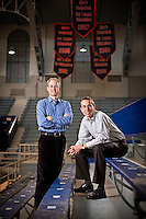 Editorial portrait of two men on bleachers in a high school gymnasium