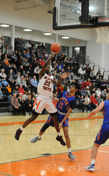 Newton North freshman Kyle Bovell looks to score during the game against Newton South at Newton North, Dec. 27, 2018.   [Wicked Local Photo/James Jesson]