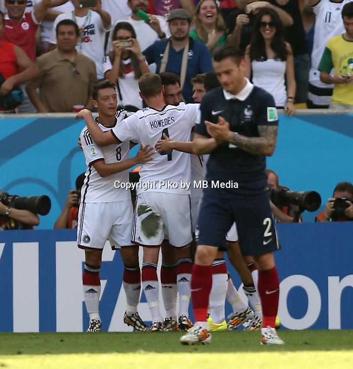 Fifa Soccer World Cup - Brazil 2014 - <br /> FRANCE (FRA) Vs. GERMANY (GER) - Quarter-finals - Estadio do MaracanaRio De Janeiro -- Brazil (BRA) - 04 July 2014 <br /> Here German team celebrating first goal. Scoring the match 0-1. German players Mesut OEZIL(8),  Benedikt HOEWEDES (4) and Mats HUMMELS (5).<br /> &copy; PikoPress